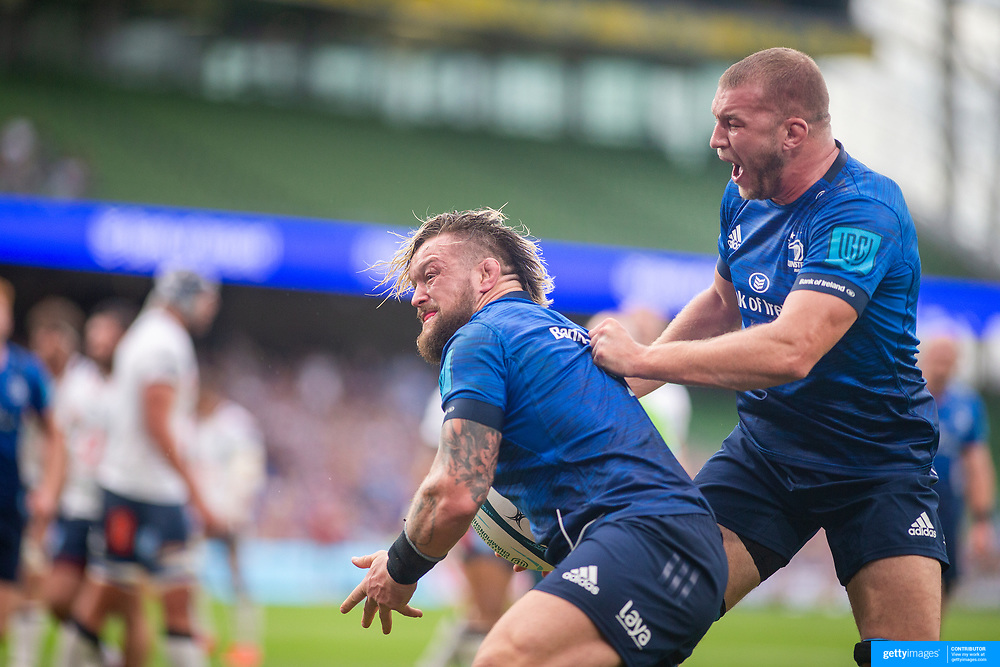 DUBLIN, IRELAND:  September 25:  Andrew Porter #1 of Leinster celebrates with team mate Ross Molony #4 of Leinster after scoring his sides second try during the Leinster V Bulls United Rugby Championship match at Aviva Stadium on September 25th, 2021 in Dublin, Ireland. (Photo by Tim Clayton/Corbis via Getty Images)