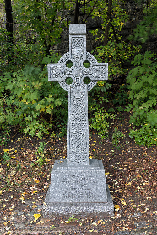 The Rideau Canal Workers' Celtic Cross Memorial next to the Rideau Canal (Ottawa Locks 1-8) in Ottawa, Ontario, Canada.  The cross pays tribute to the approximately 1000 workers who lost their lives accidents and disease while constructing the canal from 1826-1832.