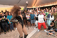 Beyonce female impersonator Teysha performs during a fundraiser after the Pulse nightclub shooting in Orlando, Fla., Thursday, June 23, 2016. (Phelan M. Ebenhack via AP)