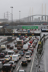© Licensed to London News Pictures. 23/12/2013. As a storm batters Britain, the QE2 bridge crossing at Dartford has been closed. The closure is expected to last over 12 hours with the crossing opening early on Christmas eve morning. Queues started to build for the Dartford tunnels as they switched to two-way operation. Credit : Rob Powell/LNP
