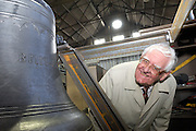 UK, Bridport - Monday, March 09, 2009: Brian Horrell with bell #6 at Nicholson Engineering. The bell and frame are destined for St Mary's Church, Hugh Town, Isles of Scilly. (Image by Peter Horrell / http://www.peterhorrell.com)