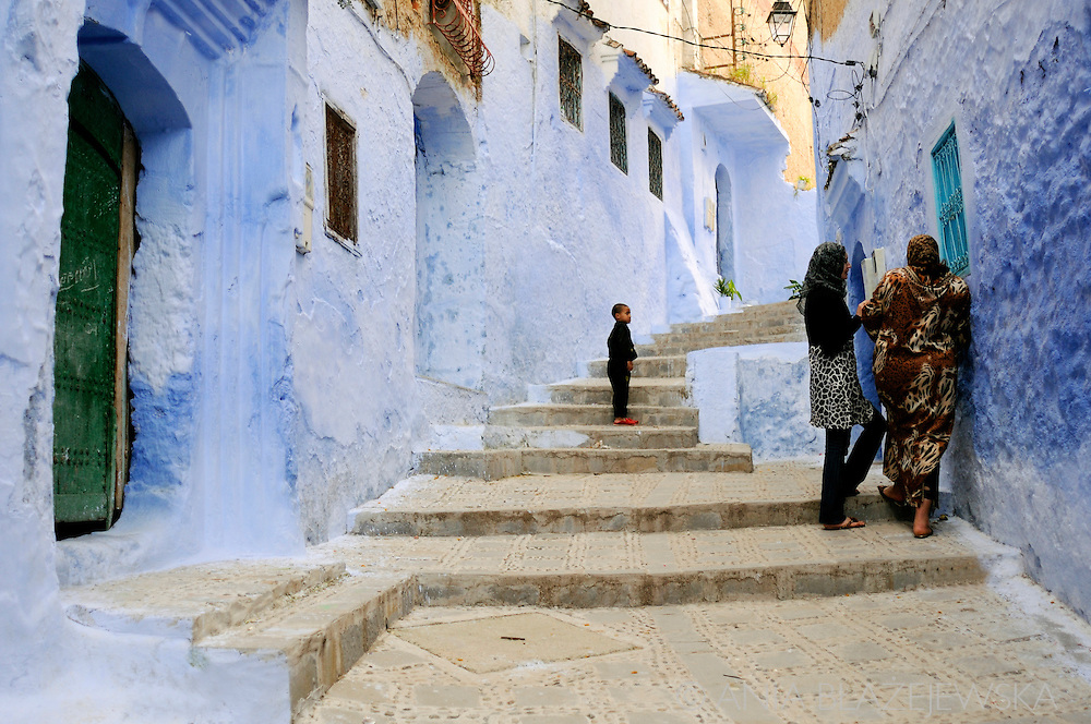 Morocco, Chefchaouen. People on the streets of the blue medina in Chefchaouen.