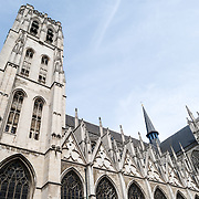 The exterior of the nave at the Cathedral of St. Michael and St. Gudula (in French, Co-Cathédrale collégiale des Ss-Michel et Gudule). A church was founded on this site in the 11th century but the current building dates to the 13th to 15th centuries. The Roman Catholic cathedral is the venue for many state functions such as coronations, royal weddings, and state funerals. It has two patron saints, St Michael and St Gudula, both of whom are also the patron saints of Brussels.
