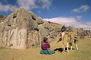 Pack Llama & Quechua Indian at Sacsayhuaman<br />Near Cusco, PERU. South America<br />Ancient Inca Ruins
