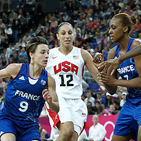 11 August 2012: France Celine Dumerc drives past USA Diana Taurasi during 86-50 Team USA victory over Team France, during the Women's Gold Medal Game, at the North Greenwich Arena, in London, Great Britain.