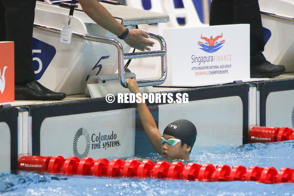 Reagan Cheng reacts after his 50m freestyle race at the 47th Singapore National Age Group Swimming Championships. He finished first among the 8-year-olds with a timing of 35.14s, which was just 0.02 seconds off the meet record. (Photo © Chua Kai Yun/Red Sports)