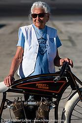 Gloria Struck on Matt Harris' early Harley-Davidson racer on the New Smyrna Speedway after the Sons of Speed Race during Daytona Bike Week. New Smyrna Beach, FL. USA. Saturday March 17, 2018. Photography ©2018 Michael Lichter.