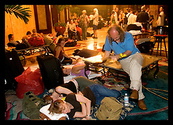 1st Sept, 2005. Hurricane Katrina, New Orleans, Louisiana. Foreign tourists cram into the lobby of the darkened Hyatt hotel with all their belongings as they await evacuation from the flooded city.