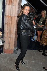Artist CINDY LASS and her dog Flash at the 10th anniversary of George in association with The Dog's Trust held at George, 87-88 Mount Street, Mayfair, London on 13th September 2011.