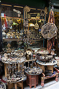 Metal objects in antique shop inside The Grand Bazaar, Kapalicarsi, great market in Beyazi, Istanbul, Turkey