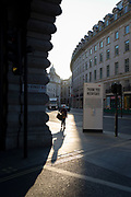 With a further 149 reported dying from Coronavirus in the last 24hrs, taking the UK death toll to 43,320, a Londoner walks past social distance advice post with a hand sanitiser dispenser, on Regent Street during the Covid pandemic, on 25th June 2020, in London, England.