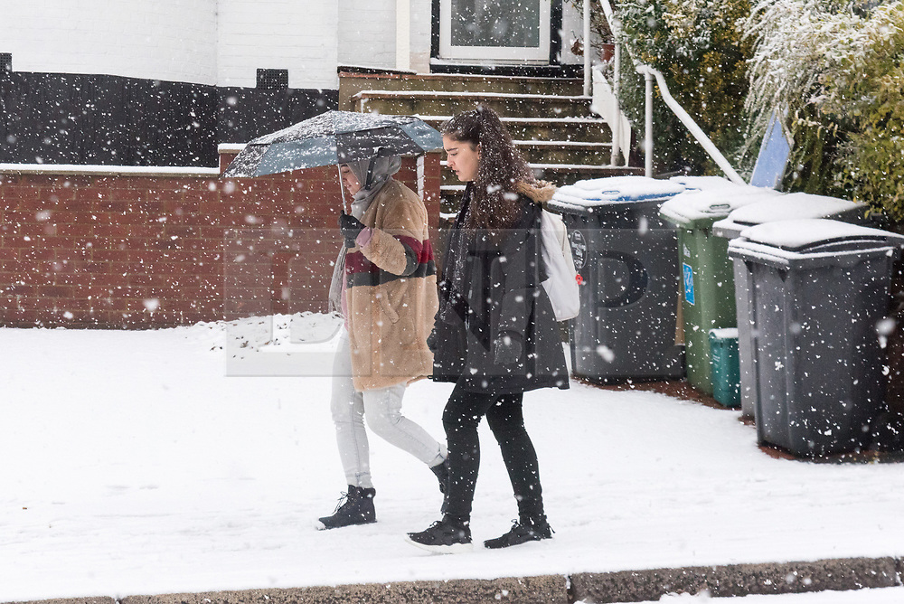 © Licensed to London News Pictures. 10/12/2017. London, UK. Woman walk early morning along the roads of Wembley, North London. Heavy snow weather hit the capital causing travel disruption. Photo credit: Ray Tang/LNP