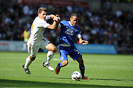 Everton's Steven Pienaar ® holds off Swansea city's Angel Rangel. Barclays Premier league, Swansea city v Everton at the Liberty stadium in Swansea, South Wales on Sat 22nd Sept 2012.   pic by  Andrew Orchard, Andrew Orchard sports photography,