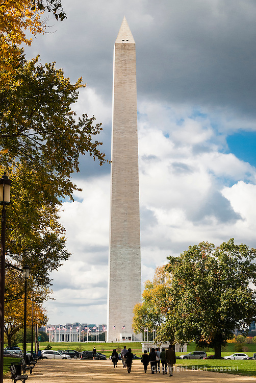 Visitors walk toward the Washington Monument on The Mall, Washington, DC