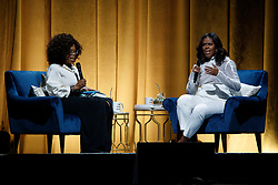 "Michelle Obama and Oprah Winfrey discuss the former first lady's book ""Becoming"" during the first stop of her book tour at the United Center Tuesday, November 13, 2018 in Chicago, IL, USA. Photo by Armando L. Sanchez/Chicago Tribune/TNS/ABACAPRESS.COM"