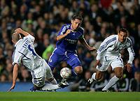 Photo: Tom Dulat.<br /> Chelsea v Shalke 04. Group B, UEFA Champions League. 24/10/2007.<br /> Fabian Ernst(L) of Shalke 04 managed to get the ball away form Frank Lampard of Chelsea.