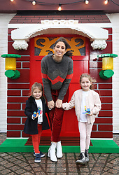 EDITORIAL USE ONLY Stacey Solomon with her nieces Mila Brent (3, left) and Darcy Brent (5) at the LEGO Imaginarium, which is open for this weekend only on London's Southbank.