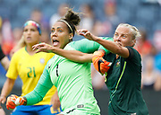 Brazil goalkeeper Bárbara (1) and Australia midfielder Tameka Butt (13) battle for position during a corner kick in the first half of the Tournament of Nations soccer match in Kansas City, Kan., Thursday, July 26, 2018. (AP Photo/Colin E. Braley)