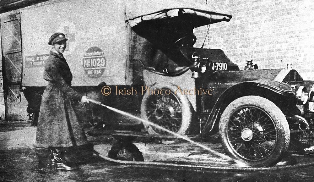 World War I: Volunteer English woman driver washing down her ambulance, a converted Wolseley, donated towards the war effort: Cambridge 1915 .