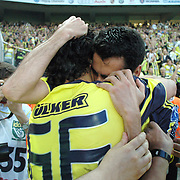 Fenerbahce's Daniel Gonzalez GUIZA (B) celebrate his goal with Mehmet TOPUZ (F) during their Turkish superleague soccer derby match Fenerbahce between Trabzonspor at the Sukru Saracaoglu stadium in Istanbul Turkey on Sunday 16 May 2010. Photo by TURKPIX