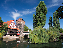 View of historic Wine Vault or Weinstadel, water tower and Hangman's Way or Henkersteg  beside Pegnitz River in Nuremberg, Germany
