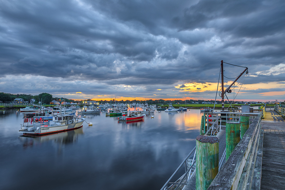 Only in Massachusetts storm clouds approaching after sunset over Marshfield Town Pier, one of New England's most scenic harbor locations. The amount of fishing boats, yachts, sailboats, and dinghies makes it an inspiring Massachusetts photography hot spot.<br /> <br /> Marshfield Town Pier after sunset photography photos are available as museum quality photo, canvas, acrylic, wood or metal prints. Wall art prints may be framed and matted to the individual liking and New England interior design projects decoration needs.<br /> <br /> Good light and happy photo making!<br /> <br /> My best,<br /> <br /> Juergen