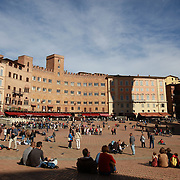 SIENA, ITALY - OCTOBER 28: The Piazza del Campo in Siena, Italy. Siena is a city in central Italy's Tuscany region, is distinguished by its medieval brick buildings. The fan-shaped central square, Piazza del Campo, is the site of the Palazzo Pubblico, the Gothic town hall, and Torre del Mangia, a slender 14th-century tower with sweeping views from its distinctive white crown. Siena, Italy. 28th October 2017. Photo by Tim Clayton/Corbis via Getty Images)