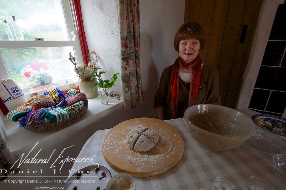 Dearbhaill Standu demonstrates the traditional foods of early rural Ireland at the Cnoc Suain, Connemara hill village, Ireland.