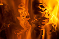 Abstract fire. Red and yellow color fluid floating shapes with many shades in fire flame.