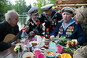 Moscow, Russia, 09/05/2011..Russian World War Two veterans and well-wishers sing as they gather in Gorky Park during the country's annual Victory Day celebrations.