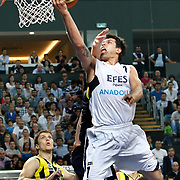 Efes Pilsen's Cenk AKYOL (R) during their Turkish Basketball Legague Play-Off semi final second match Efes Pilsen between Fenerbahce at the Sinan Erdem Arena in Istanbul Turkey on Friday 27 May 2011. Photo by TURKPIX