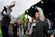 Seattle Sounders defender Saad Abdul-Salaam holds up the MLS Cup trophy, on stage with teammates, including midfielder and captain Nicolas Lodeiro, right, during the MLS Cup Champions Parade & Rally on November 12, 2019 in Seattle, Washington, to celebrate the Sounders' win over Toronto FC to win the MLS Cup soccer match in Seattle. (Alika Jenner/Image of Sport)