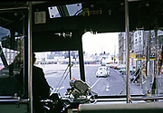 View out of front window of bus next to driver's seat in city centre of Amsterdam, Netherlands 1973