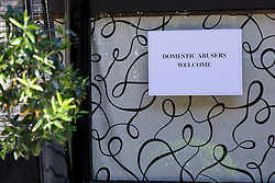 """© Licensed to London News Pictures. 08/06/2014. LONDON, UK. A sign left at the entrance of Scott's Restaurant in Mayfair reads """"Domestic abusers welcome"""", photographed on Sunday. 8 June 2014. In June 2013, Nigella Lawson was pictured apparently being 'throttled' by Charles Saatchi at the same spot outside Scott's. Photo credit : Tolga Akmen/LNP"""