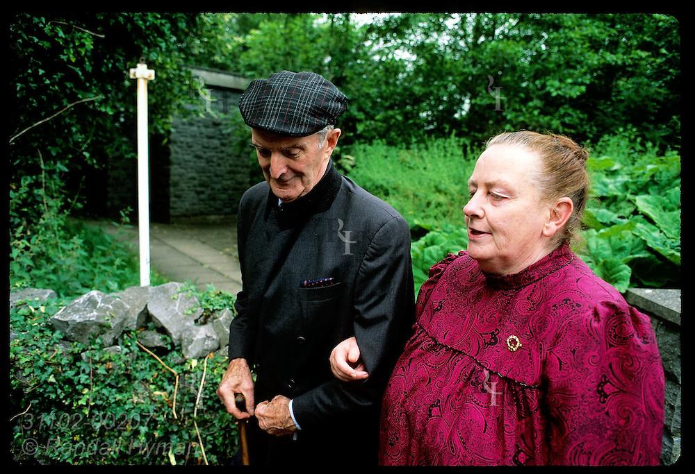 Retired schoolteacher Tom Hannon walks with wife to attend Yeats seminar at Thoor Ballylee; Gort. Ireland