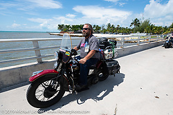 Jim Gilfoyle riding Midge, his Class III 1938 Harley-Davidson El Knucklehead in the Cross Country Chase motorcycle endurance run from Sault Sainte Marie, MI to Key West, FL. (for vintage bikes from 1930-1948). The staging area on a Key West pier just before the finish and near the end of the 110 mile Stage-10 ride from Miami to Key West, FL USA. Sunday, September 15, 2019. Photography ©2019 Michael Lichter.