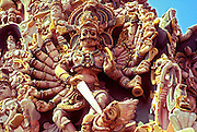 INDIA, RELIGION, HINDUISM Madurai; Meenakshi Hindu Temple; elaborately carved West Tower, detail showing Shiva