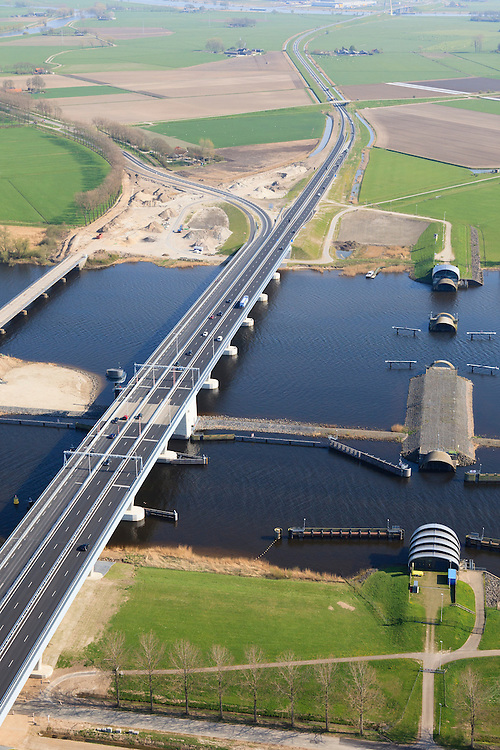 Nederland, Flevoland-Overijssel, Ramspol, 01-05-2013; de balgstuw in het Ramsdiep met strekdam naast de nieuwe Ramspolbrug in de N50 , gezien richting Overijssel.<br /> Ramspol, inflatable dike, between Ketelmeer and Black Water. The Balgstuw (bellow barrier) is a storm barrier and consists of an inflatable dam or dyke, composed of three bellows. Usually, each bellow rests on the bottom of the water, but now the bellows are inflated  because of maintenance.<br /> luchtfoto (toeslag op standard tarieven)<br /> aerial photo (additional fee required)<br /> copyright foto/photo Siebe Swart