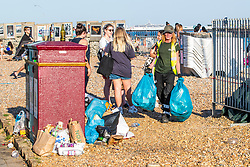 © Licensed to London News Pictures. 25/06/2020. Brighton, UK. Council workers have been working all day to stay on top of the rubbish left on the beach in Brighton and Hove by visitors. Photo credit: Hugo Michiels/LNP