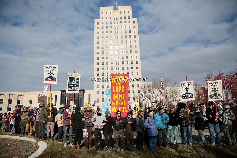 Opponents of the Dakota Access oil pipeline demonstrate on the North Dakota capitol grounds on November 14, 2016. Bismarck, North Dakota, United States.