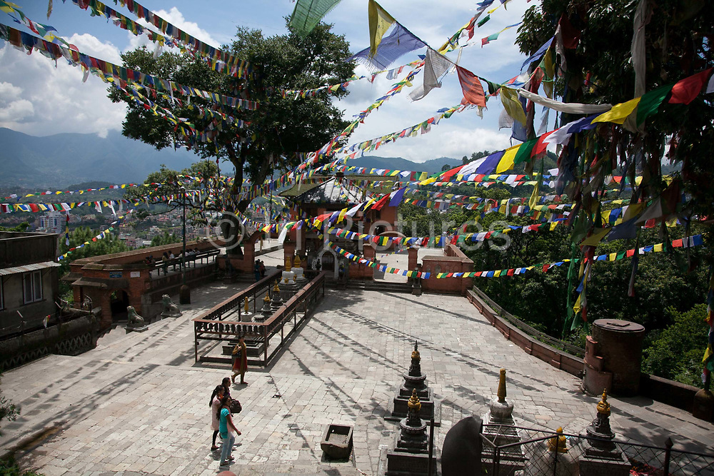 Buddhist prayer flags criss-crossing the sky at at the Swayambhunath temple complex, also called the Monkey Temple.