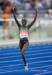 Kenya's Vivian Cheruiyot celebrates after winning the women's 5000m race of the 12th IAAF World Athletics Championships at the Olympic Stadium on August 22, 2009 in Berlin, Germany. (Photo by Vid Ponikvar / Sportida)