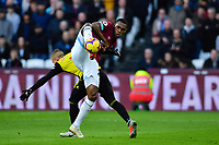 Football - 2018 / 2019 Premier League - West Ham United vs. Watford <br /> <br /> West Ham United's Issa Diop battles for possession with Watford's Gerard Deulofeu, at The London Stadium.<br /> <br /> COLORSPORT/ASHLEY WESTERN