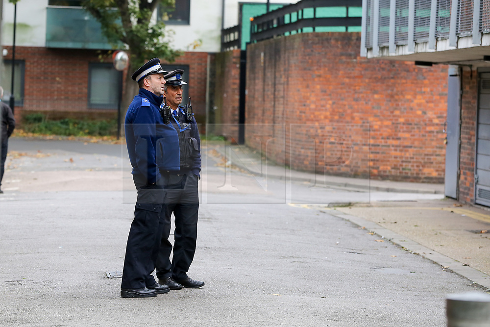 © Licensed to London News Pictures. 28/10/2019. London, UK. Police officers on Mingard Walk in Islington, north London. <br /> Detectives have launched a murder investigation after a woman died in a fire at a residential address in Islington.<br /> Police were called at 12:41hrs on Saturday, 26 October following reports of a fire in a flat on Mingard Walk, N7.<br /> Officers attended along with the London Ambulance Service and the London Fire Brigade. A woman [no further details at this time] was pronounced dead at the scene. A man, believed to be aged in his 30s, was found suffering serious injuries. He was taken to hospital where he remains in a critical condition. <br /> The fire is being treated as suspicious. Photo credit: Dinendra Haria/LNP