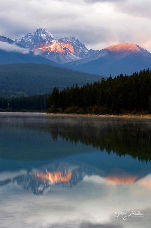 Dawn reflections in Patricia Lake, Jasper, Alberta, Canada
