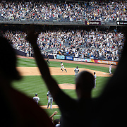 Brett Gardner, New York Yankees, rounds the bases after hitting a walk off home run in the bottom of the ninth  during the New York Yankees V Detroit Tigers Major League Baseball regular season baseball game at Yankee Stadium, The Bronx, New York. 11th August 2013. Photo Tim Clayton