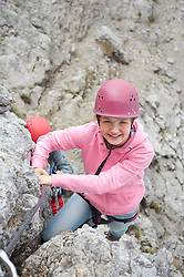 Girl young helmet climbing rocks mountains