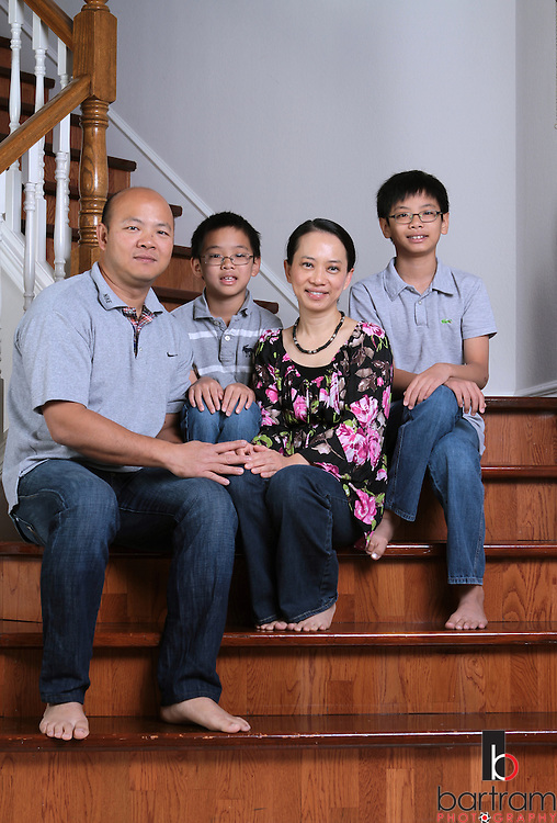 Amanda Phan is shown at home in Plano with her husband, Chupong Suwannakinthorn, and sons Dylan Suwannakinthorn, 9, and Darin Suwannakinthorn, 11.  (Photo by Kevin Bartram)
