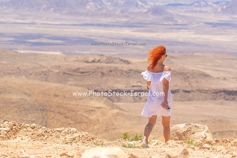 Route 10 along the Egyptian -Peaceful and tranquil along the Israeli border. Looking into Egypt from Israel Female tourist looks out at Egypt