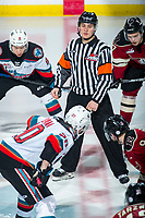 KELOWNA, BC - FEBRUARY 15: Referee Matt Hickets stands at centre ice to drop the puck between the Kelowna Rockets and the Red Deer Rebels at Prospera Place on February 15, 2020 in Kelowna, Canada. (Photo by Marissa Baecker/Shoot the Breeze)